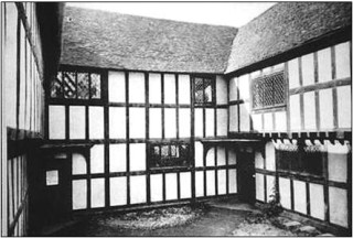 The Old Rectory showing the square courtyard and overhanging wings.