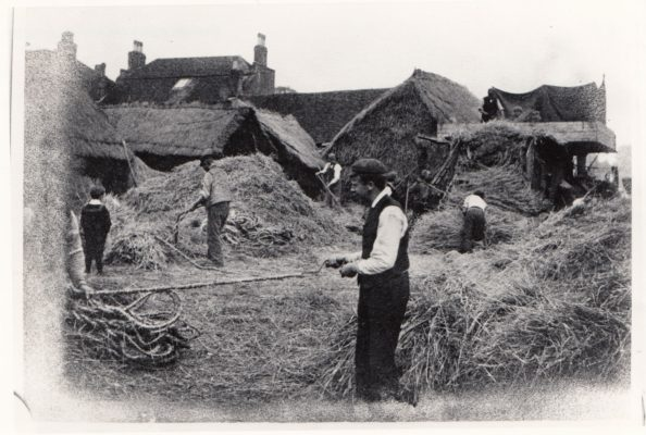 Black and white photo of man turning corn into rope | Buckinghamshire Advertiser 1973