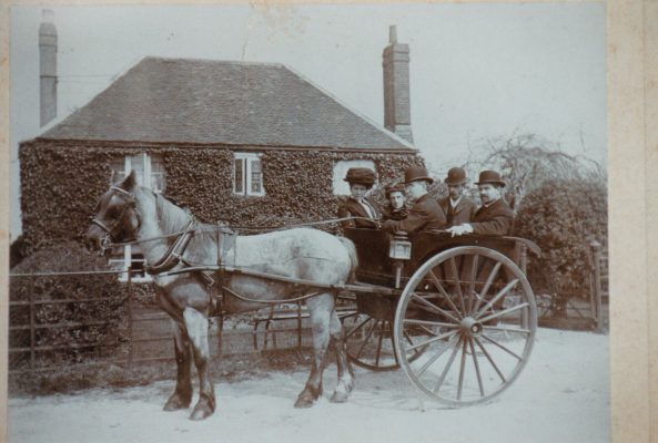 Photograph of members of the Wooster family, outside Pennbury Farm house
