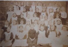 Copy of sepia photograph showing children from Church of England School, Windsor End.