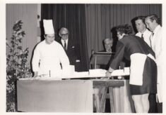 Black and white photograph of the headmaster and chef.