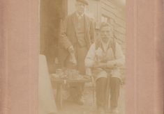Sepia photo of shoe repairer and Mr Bailey