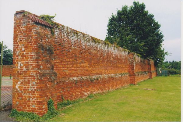 Photograph of high brick walls at Wilton Park