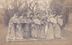Black and white postcard photograph showing a group of 7 women of the cast of The Mikado