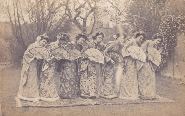 Black and white postcard photograph showing a group of 7 women of the cast of The Mikado | Unknown