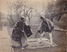 Black and white photograph showing two actors in costume from The Mikado; WFC Holden on right