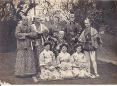 Black and white photograph showing the cast of The Mikado ; WFC Holden with mandolin