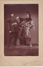 Mounted sepia photograph of two actors in costume; WFC Holden on the right