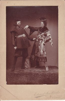 Mounted sepia photograph of two actors in costume; WFC Holden on the right | Unknown