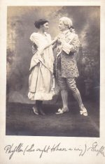Sepia postcard of characters from dramatic production