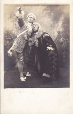 Sepia postcard of characters in dramatic production