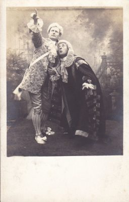 Sepia postcard of characters in dramatic production | Unknown
