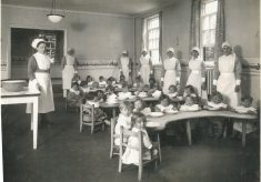 Photocopy of a photograph showing children and nurses in the new dining room