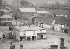 Large photograph of Aylesbury End. Showing the fields behind Days store in the foreground