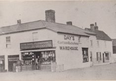 Black and white mounted photograph showing detailed view of Day's store.