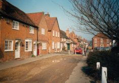 Coloured photo of properties on west side of Aylesbury End looking north