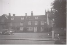 Photograph of houses in Wycombe End in front of St Mary's Church