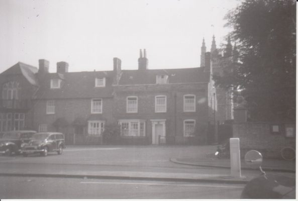 Photograph of houses in Wycombe End in front of St Mary's Church | Unknown