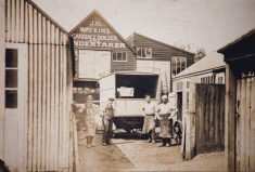 """Sepia photo of """"J H Watkins Carriage Builder & Undertaker's Yard, off Wycombe End"""