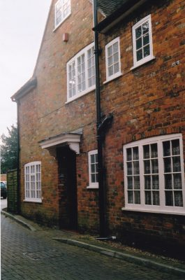 Coloured photo of side of property [in Wycombe End] | Unknown